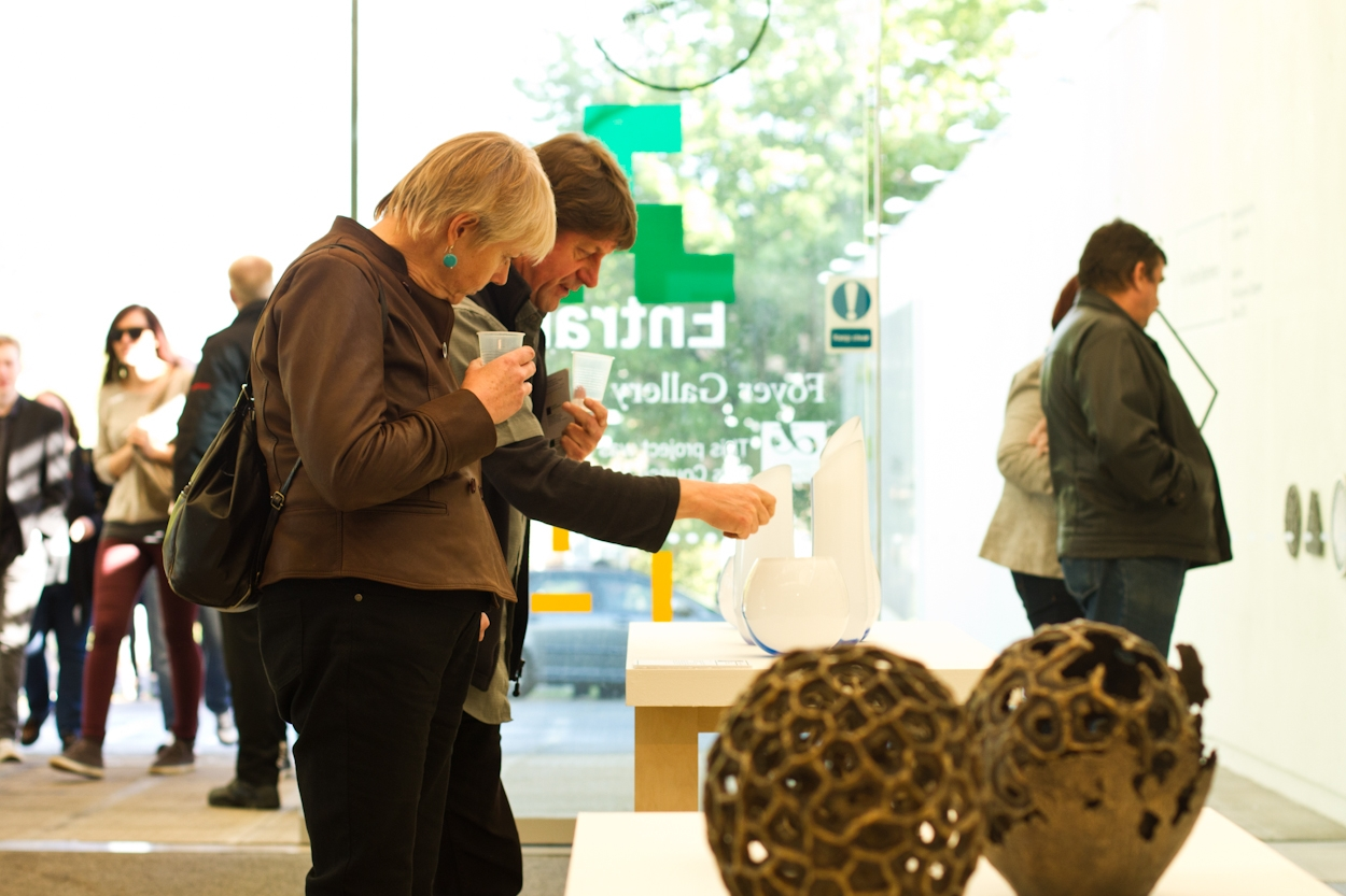 Visitors viewing artwork at the UCA BA graduation show 2013