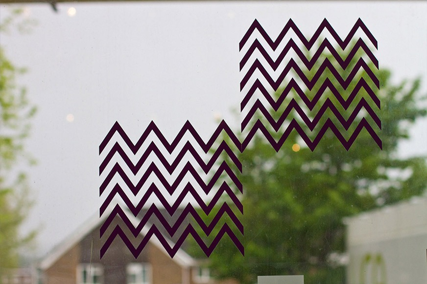 Purple zigzag pattern on gallery window