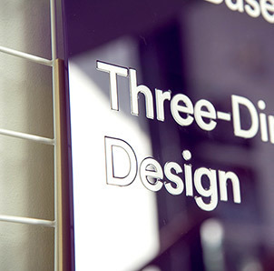 Acrylic typography inset into solid colour acrylic signage.